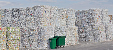 Industry know-how waste economy - piles of recycled paper